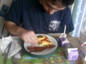 His first taste of bacon and eggs!