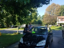 Little sis helping Linford wash his car